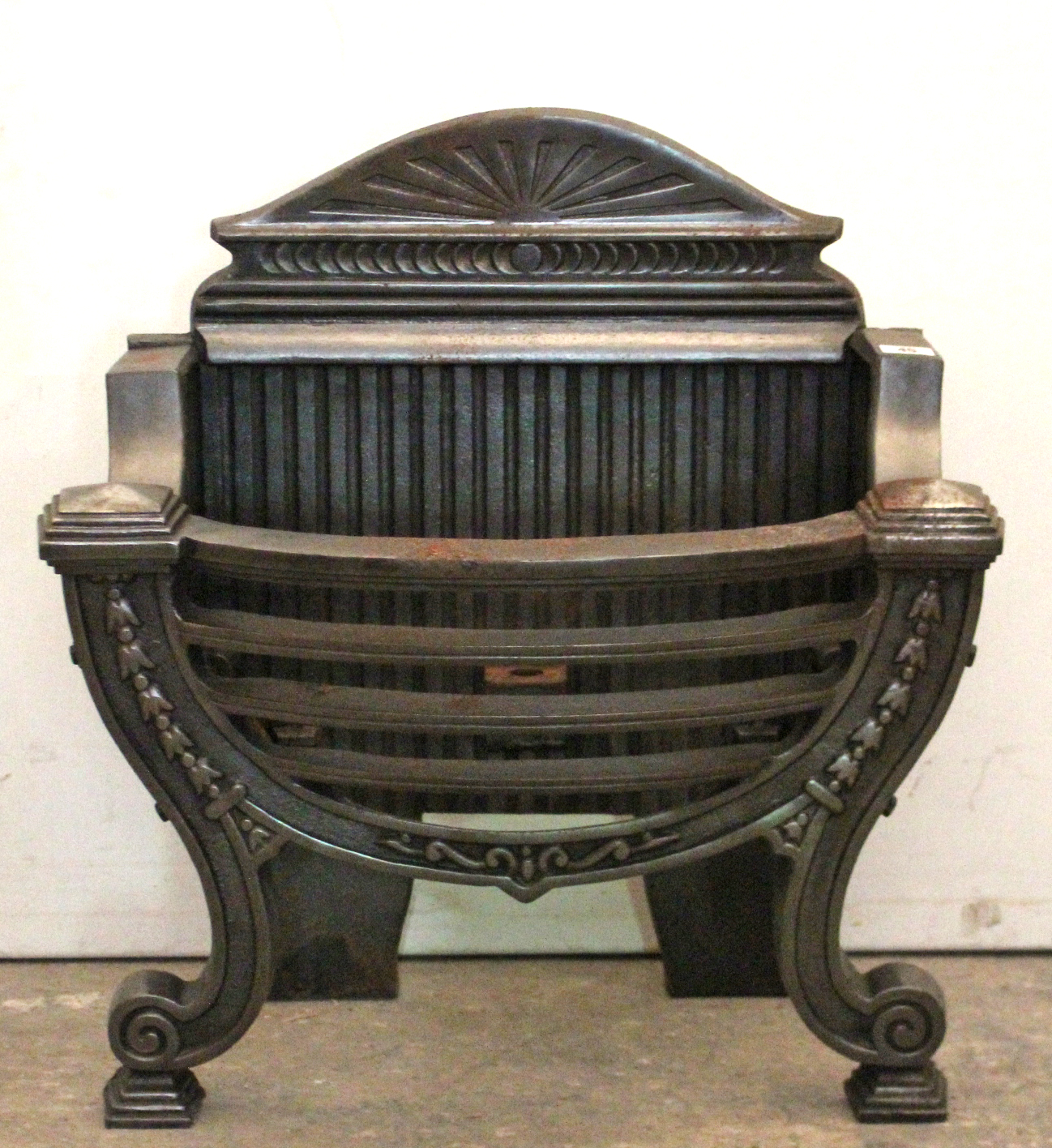 "Lot 45 - A Georgian-style cast-iron fire grate, 21½"" wide x 22½"" high."