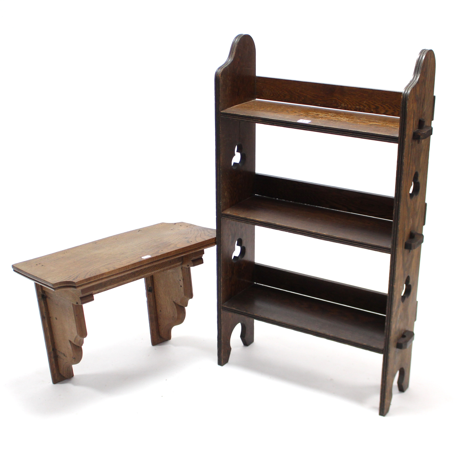 """Lot 17 - An Edwardian oak three-tier standing open bookcase with pierced & shaped end supports, 21½"""" wide x"""