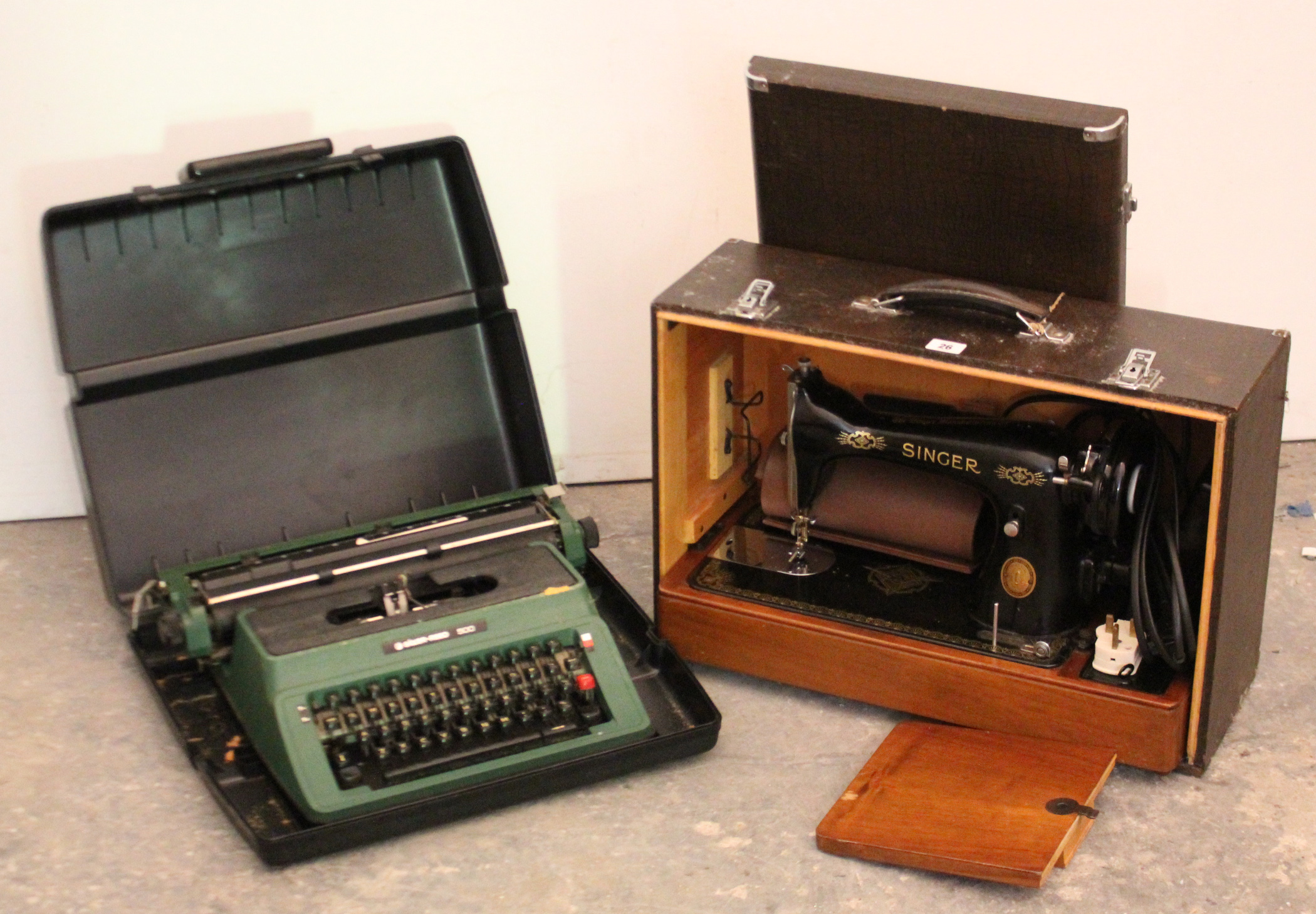 Lot 26 - A Singer electric sewing machine; & a Silver-Reed 500 portable typewriter, each with case.