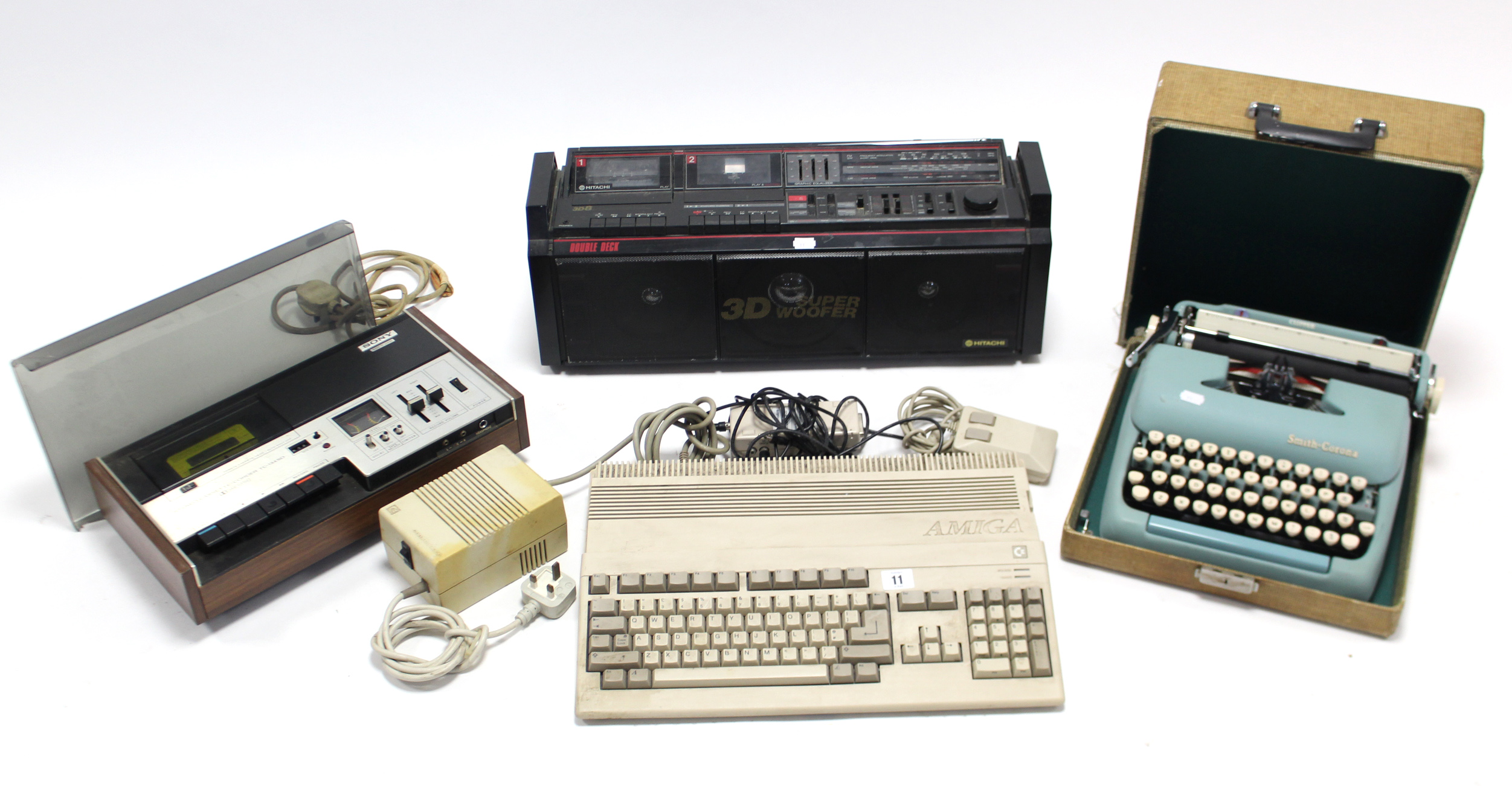"Lot 11 - A Commodore ""Amiga"" keyboard; a Sony stereo cassette recorder; an Hitachi portable stereo cassette"