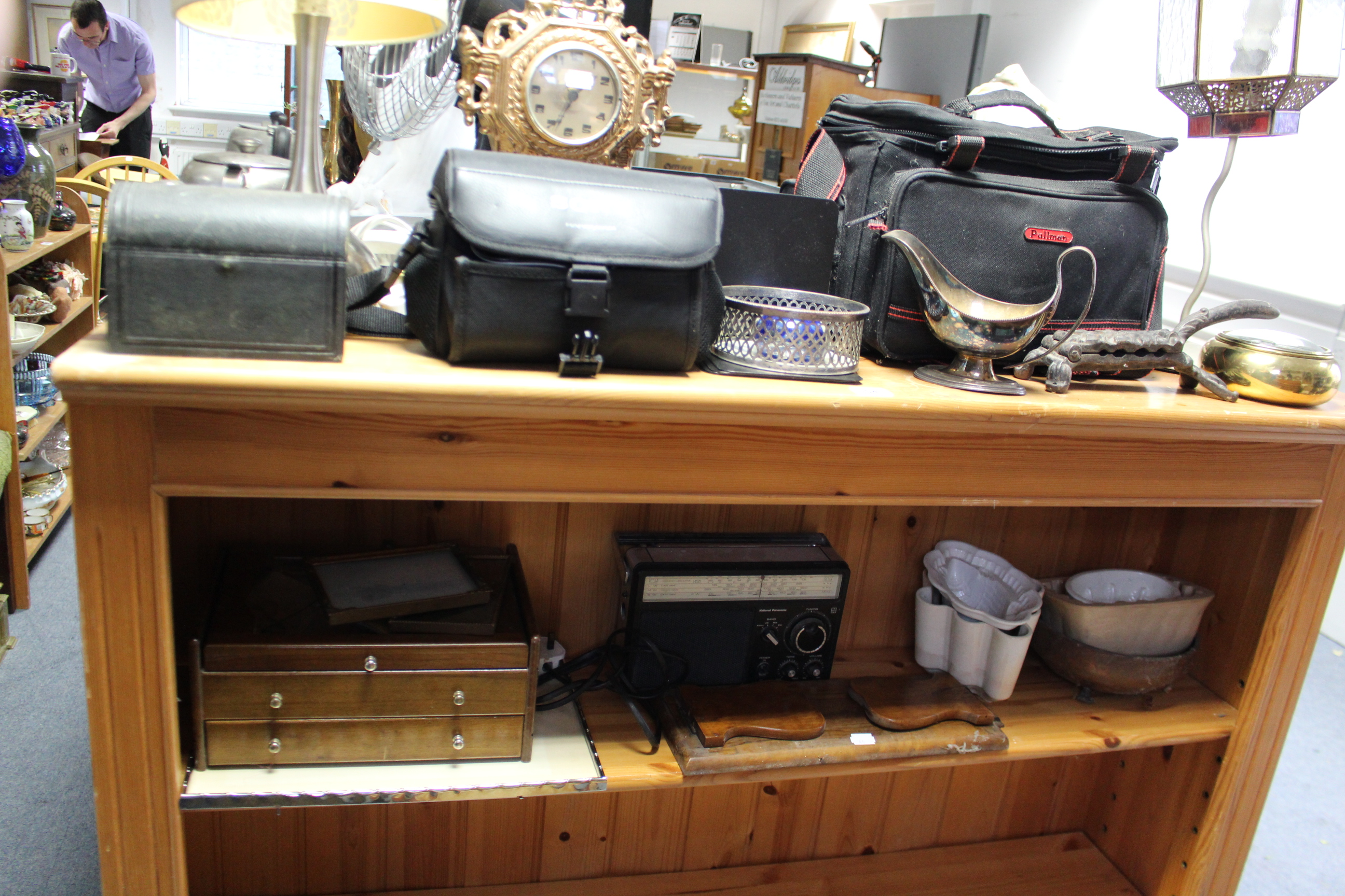 Lot 46 - Two movie cameras; two desk-top fans; a reproduction mantel clock; a pair of candlesticks; &