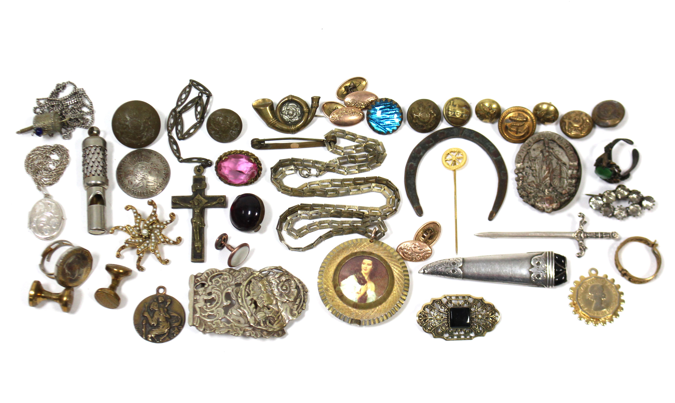 Lot 2 - A silver novelty bar brooch in the form of a sword; a silver oval photograph locket on fine-link