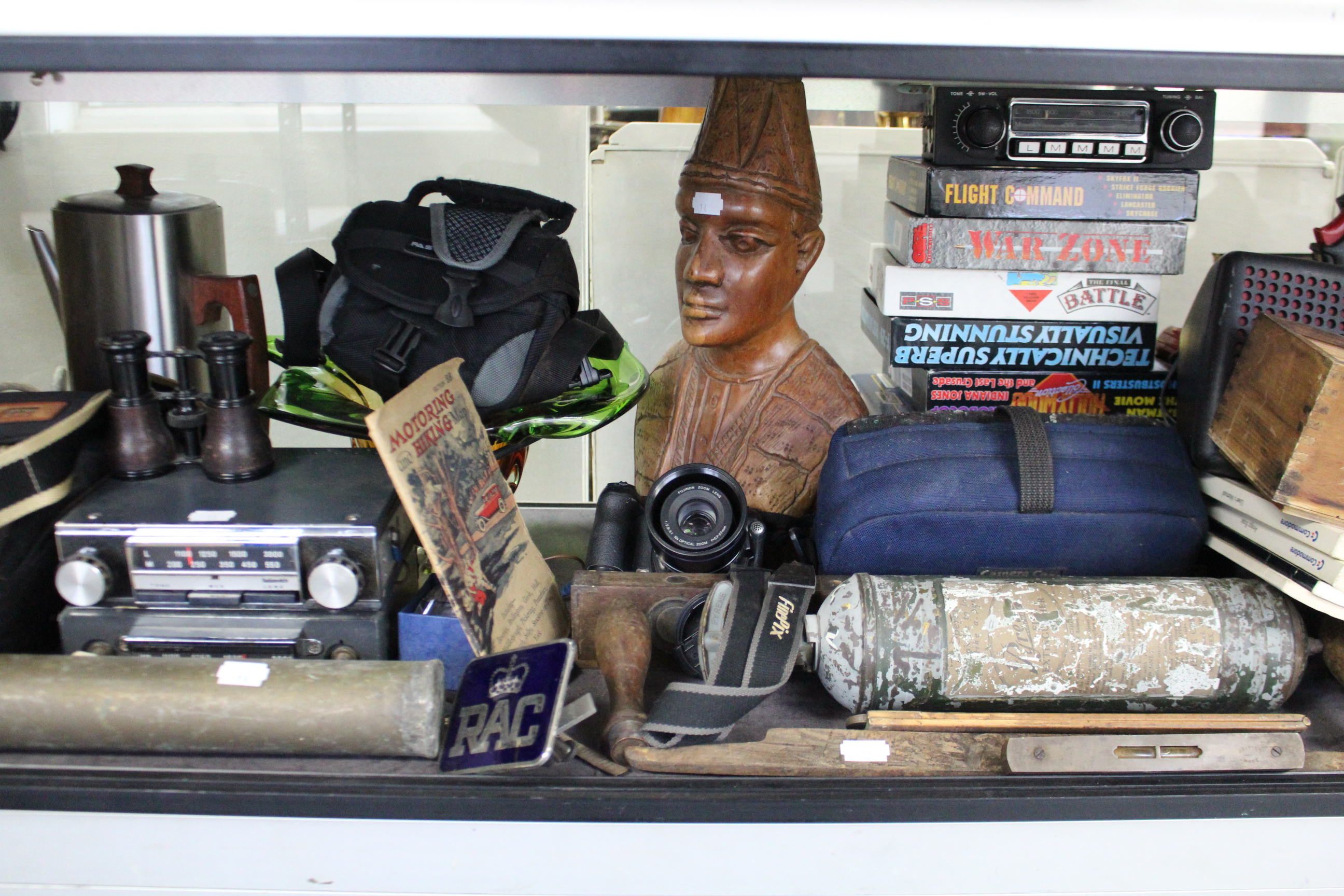 Lot 14 - Three cameras; two lenses; three car radios; various books; & sundry other items.