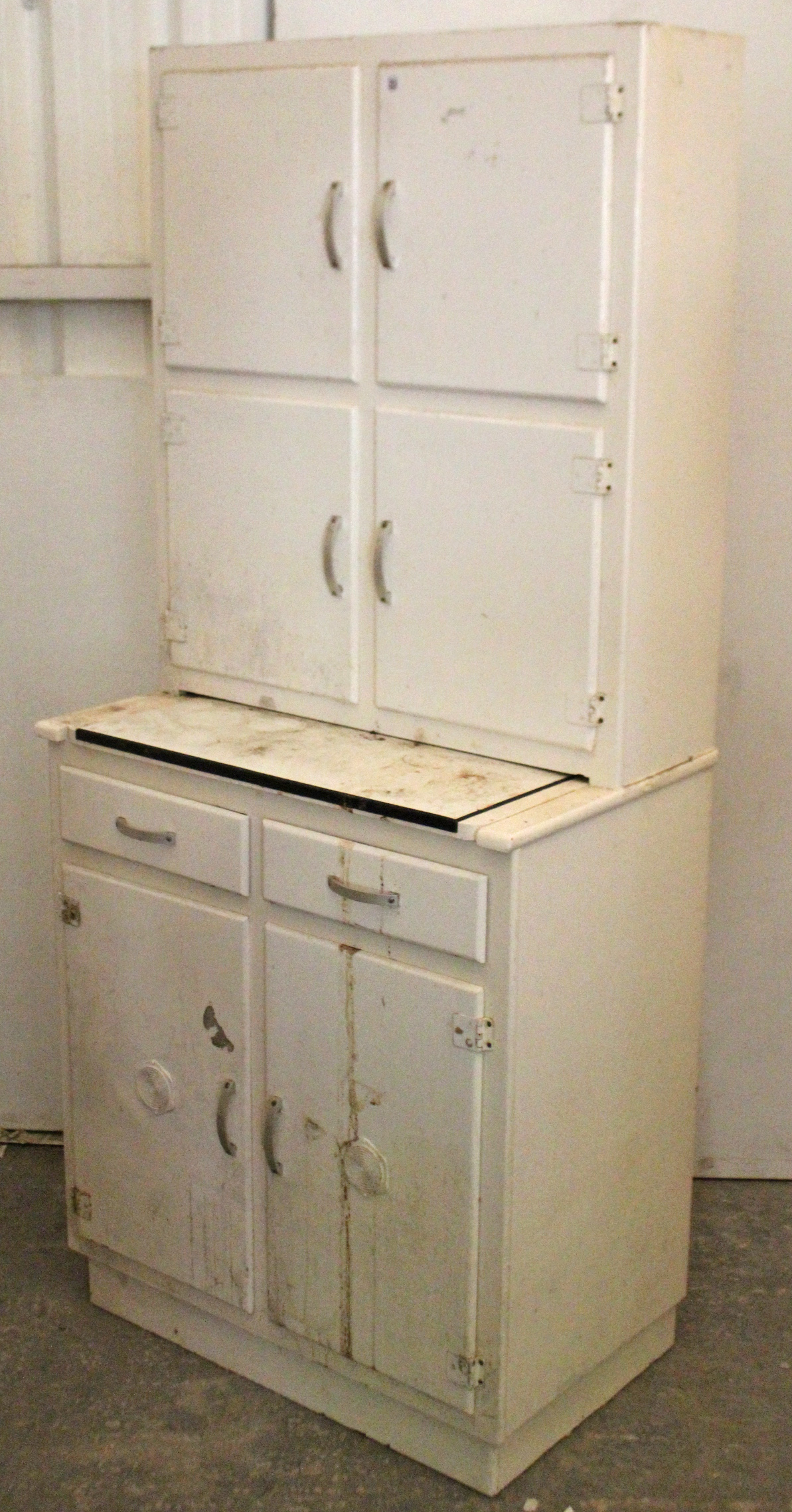 Lot 33 - A mid-20th century white painted wooden tall kitchen cabinet, fitted with an arrangement of numerous