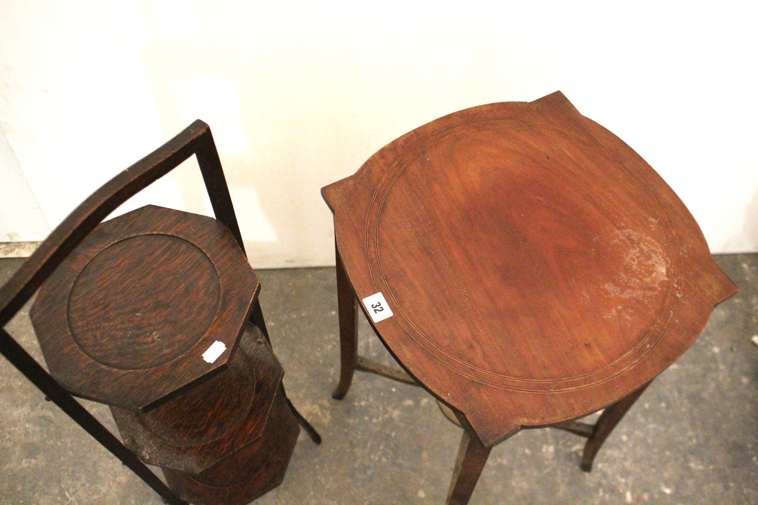 Lot 32 - An Edwardian inlaid-mahogany circular occasional table on square tapered legs with open undertier,
