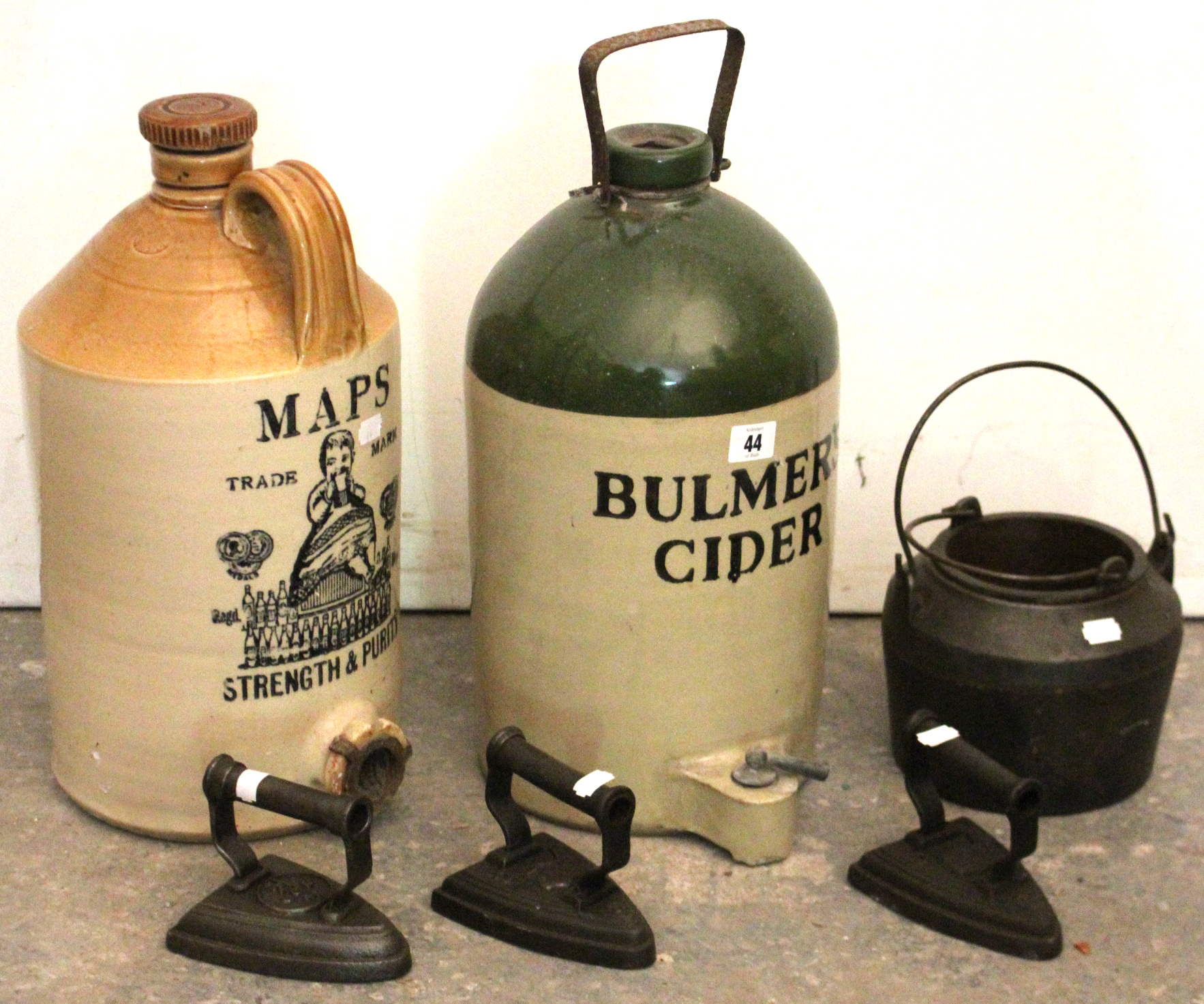 """Lot 44 - Two stoneware flagons """"Bulmers Cider""""; & """"Maps Strength Purity; an iron glue pot; & three flat-"""