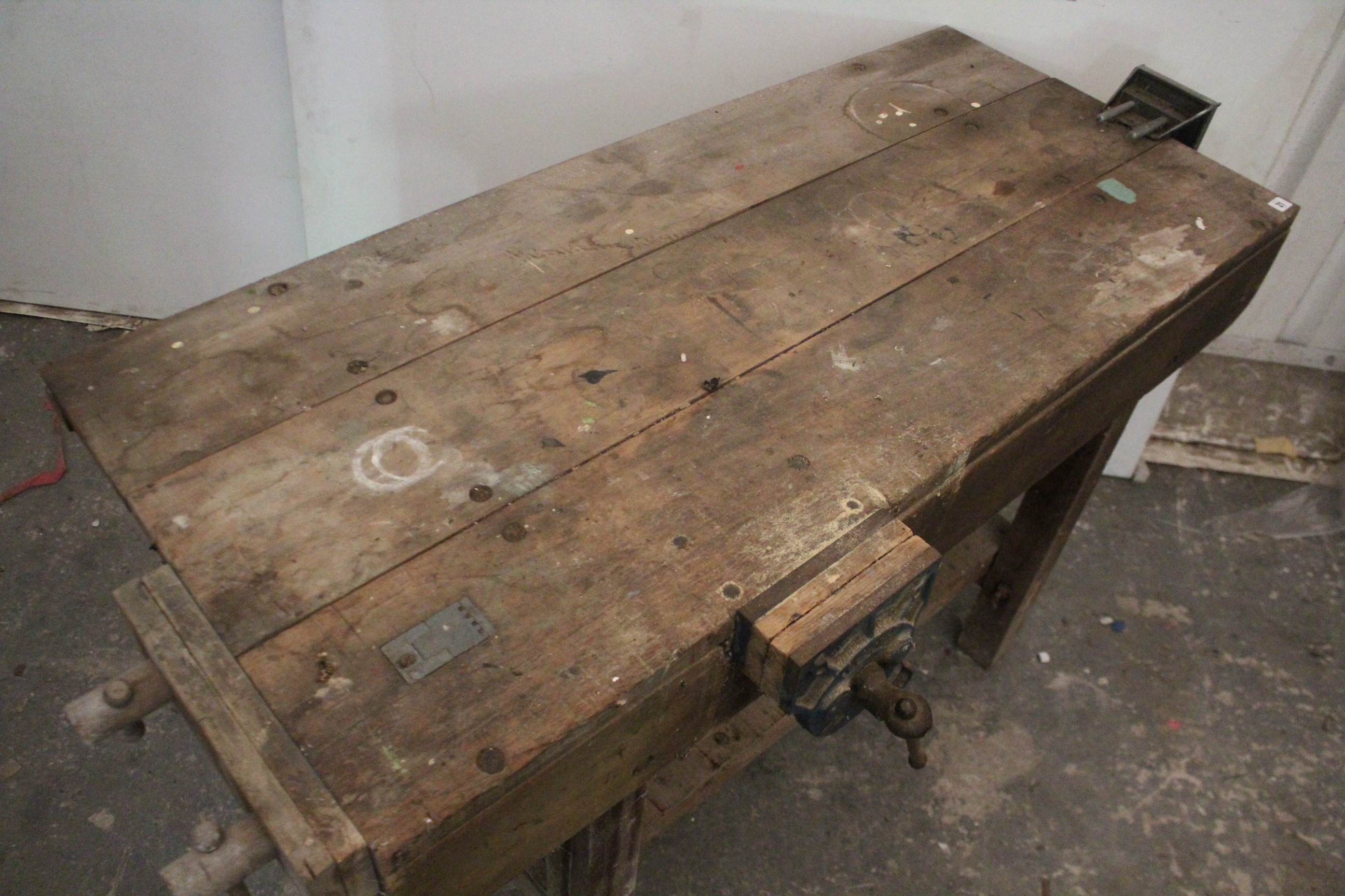 "Lot 21 - A wooden work bench fitted three clamps, & on square legs, 54"" long."