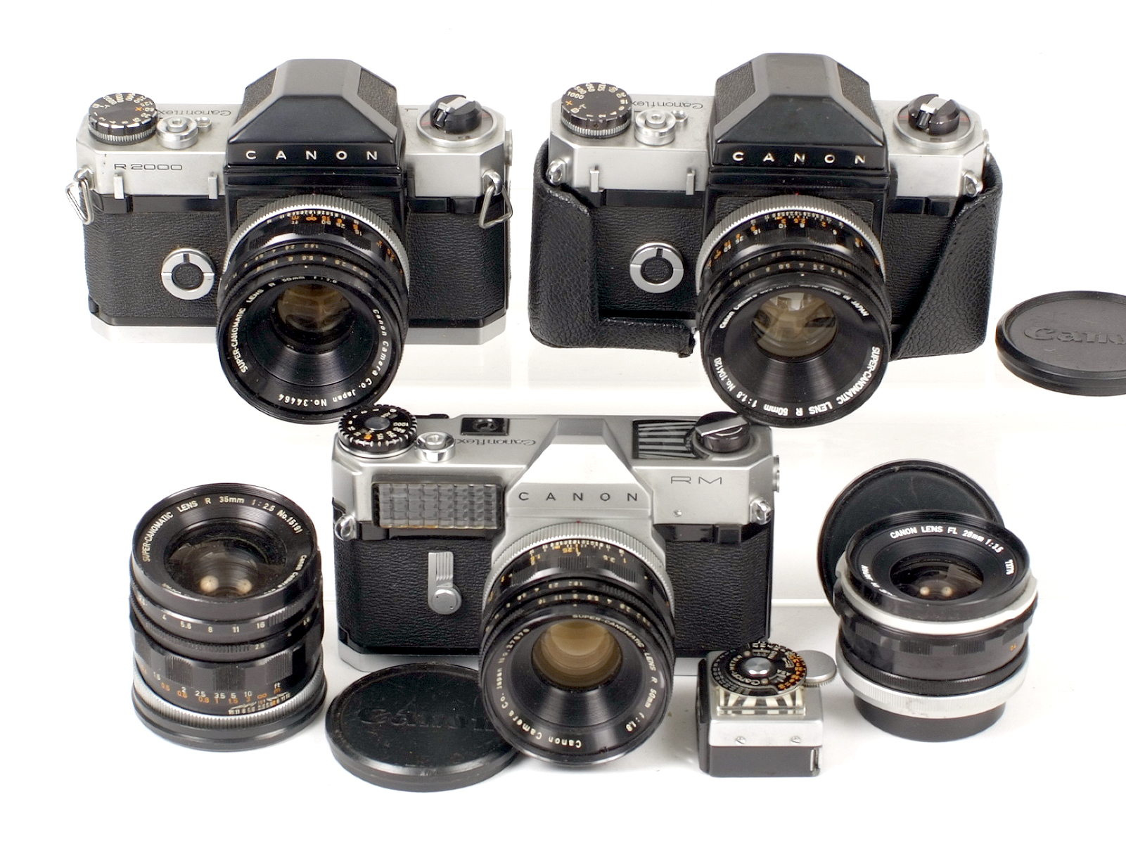 Lot 14 - A Collection of Canon Canonflex Cameras & Lenses. Comprising Canonflex RM with Super Canomatic