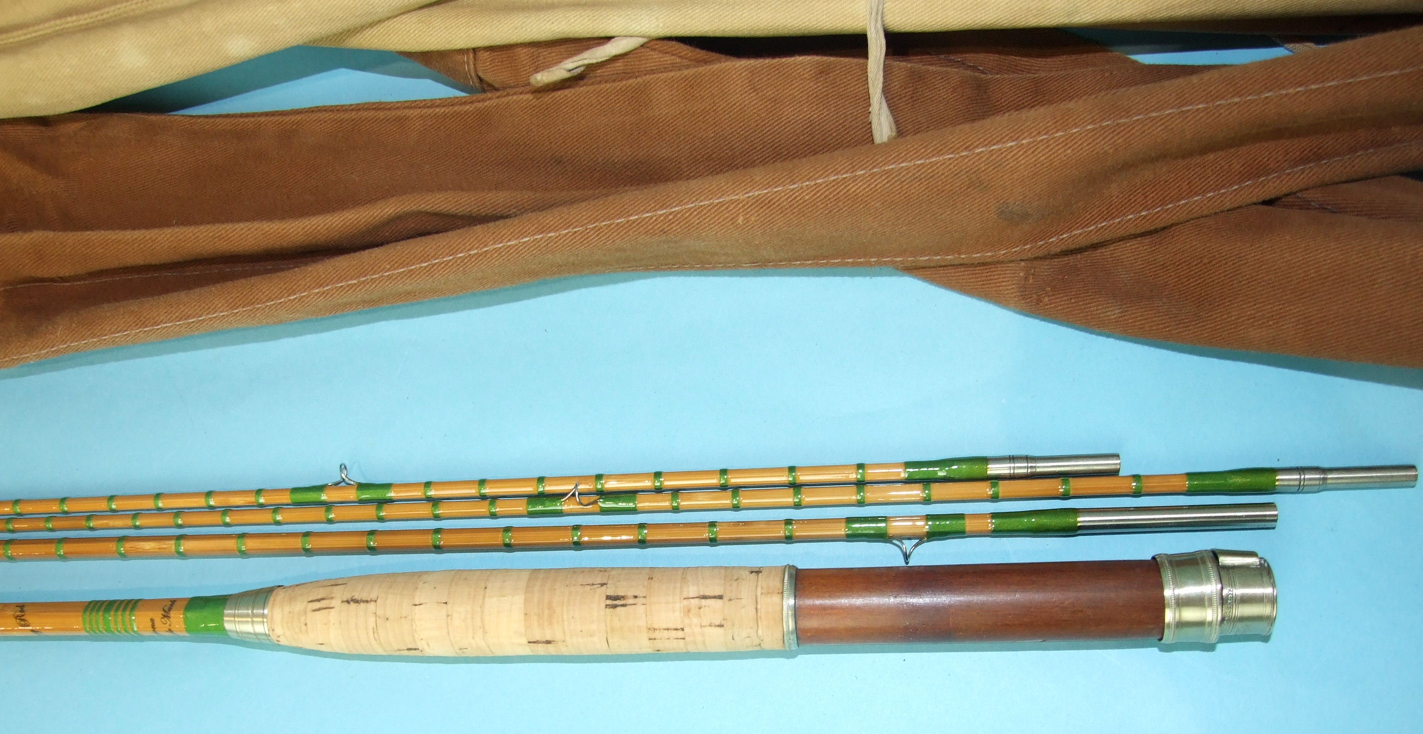 "Lot 423 - A Hardy's 9' 6"" split-cane three-piece fly rod ""The Fairy Rod"" no.44419, with spare tip, in bag."