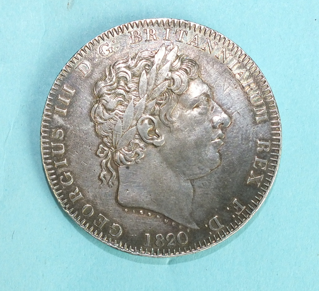 Lot 102 - A George III 1820 LX crown.