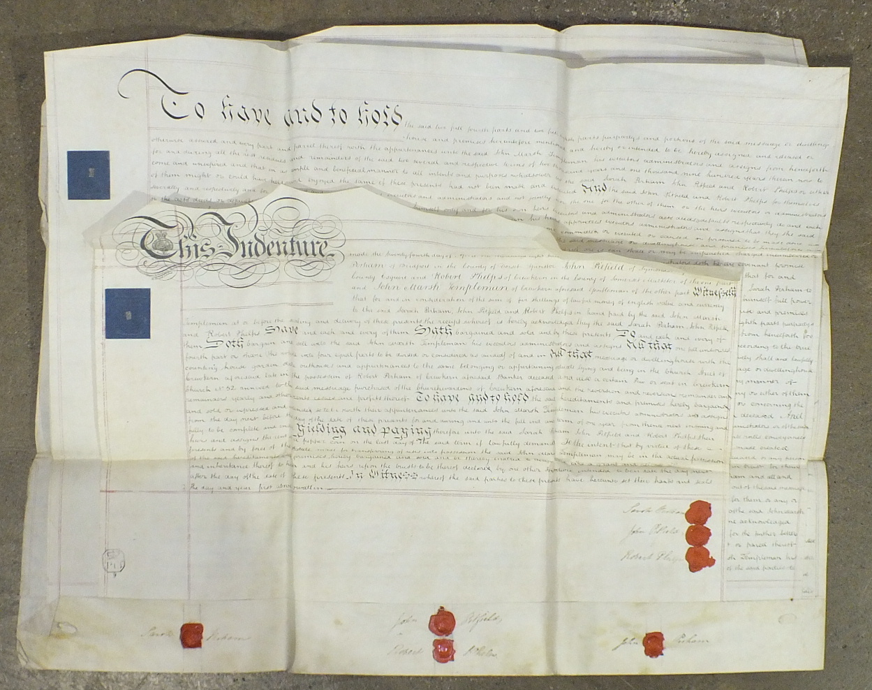Lot 72 - An early 18th century indenture, written on vellum with wax seals, and four 19th century