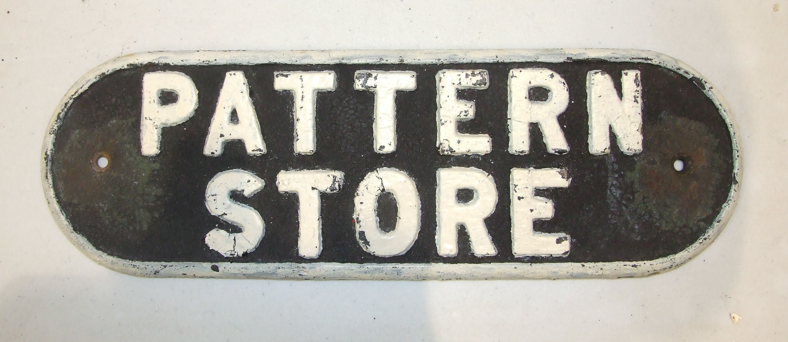 "Lot 453 - A cast iron LNER door plate ""Pattern Store"", 13 x 38cm."
