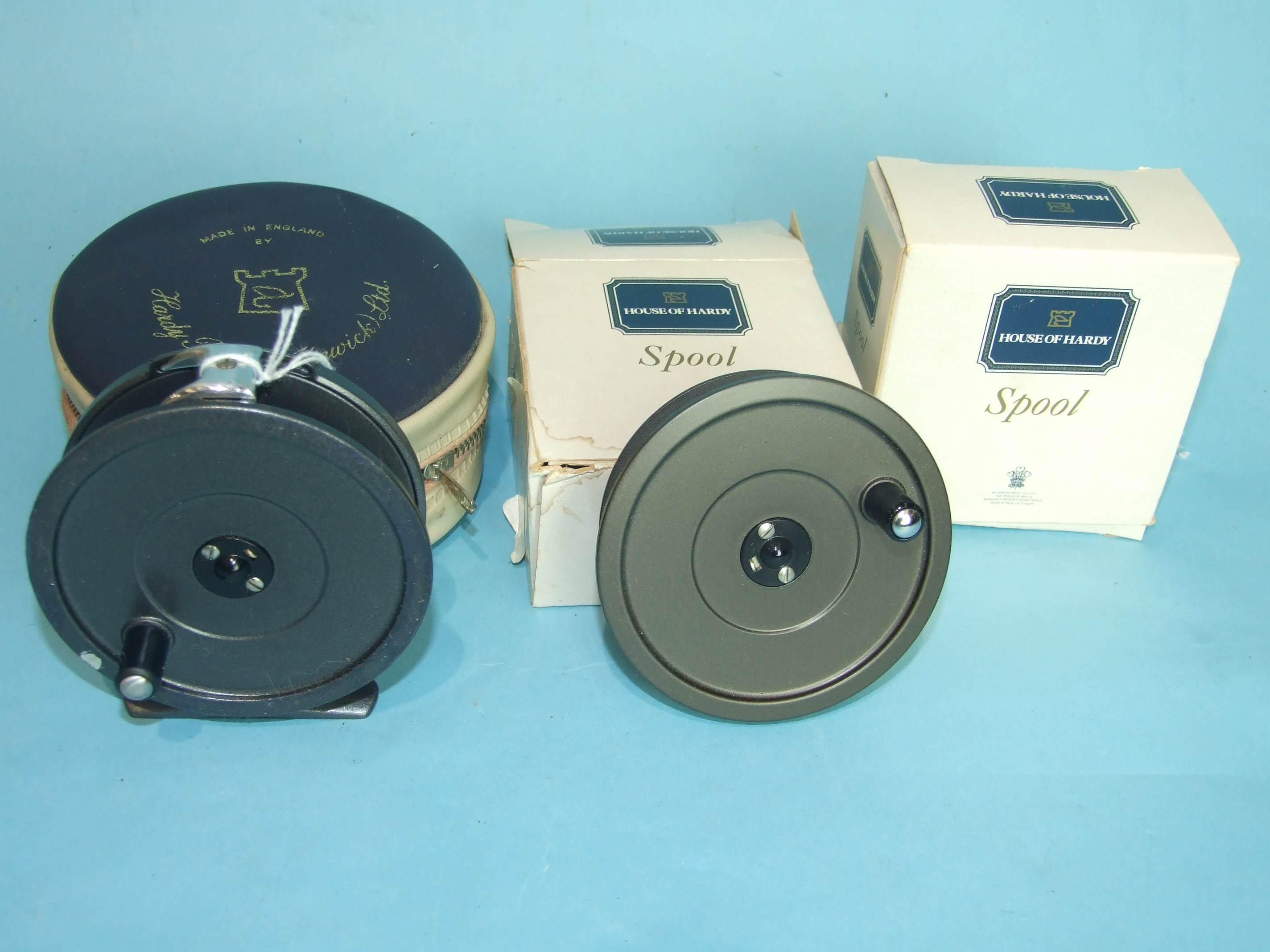 "Lot 414 - A Hardy 3½"" Uniqua fly reel and two spare spools."