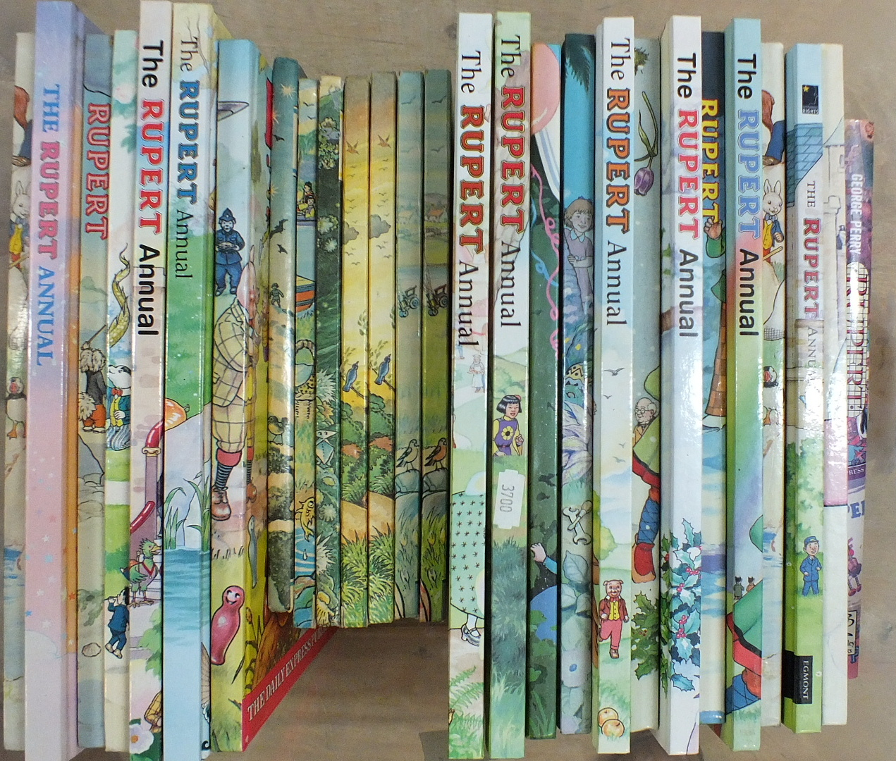 Lot 13 - Seven 1970's Rupert Annuals and twenty later issues.