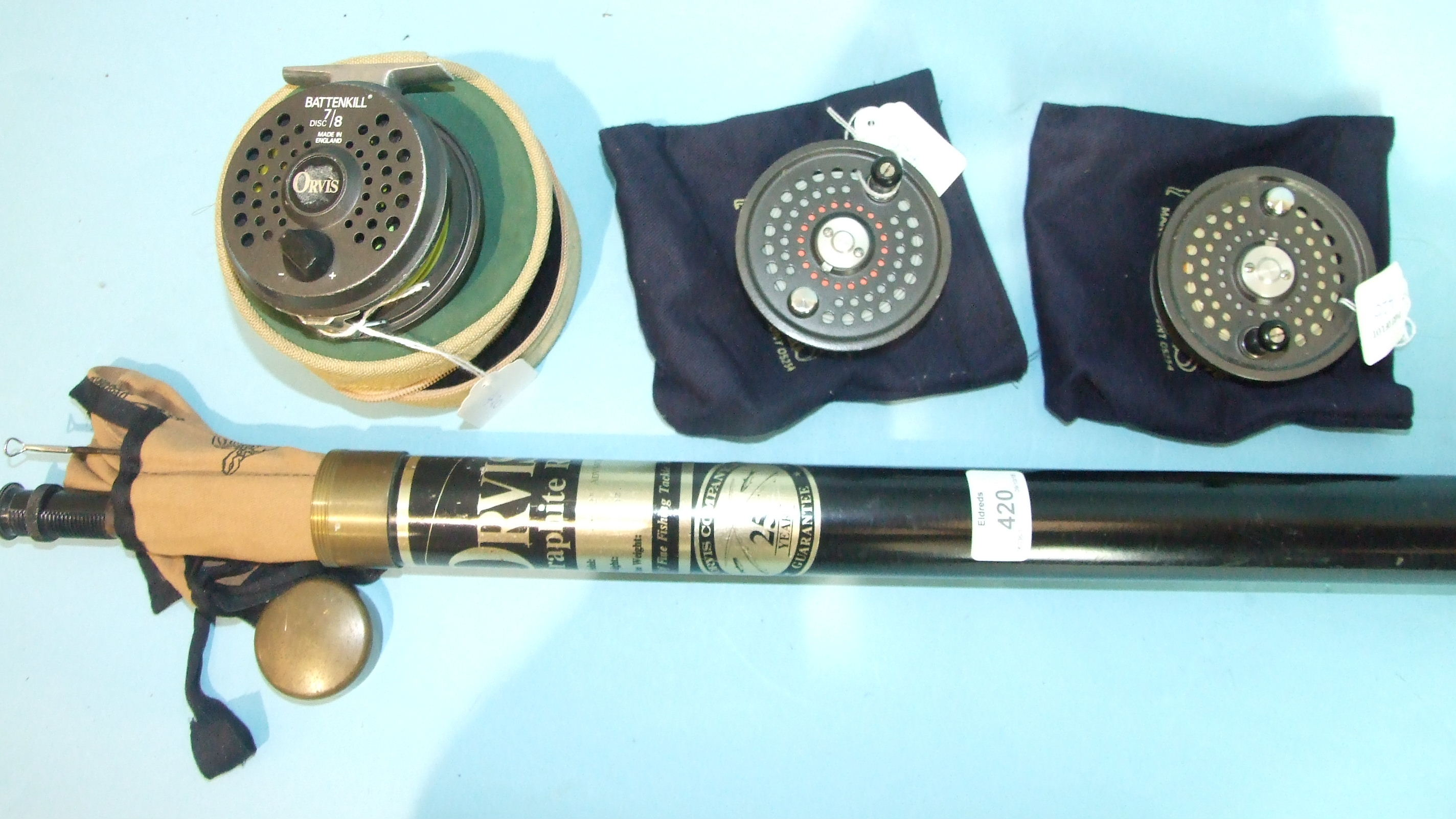 """Lot 420 - An Orvis Battenkill 7/8 3¼"""" fly reel in case and two spare spools and an Orvis 9' 3"""" graphite two-"""