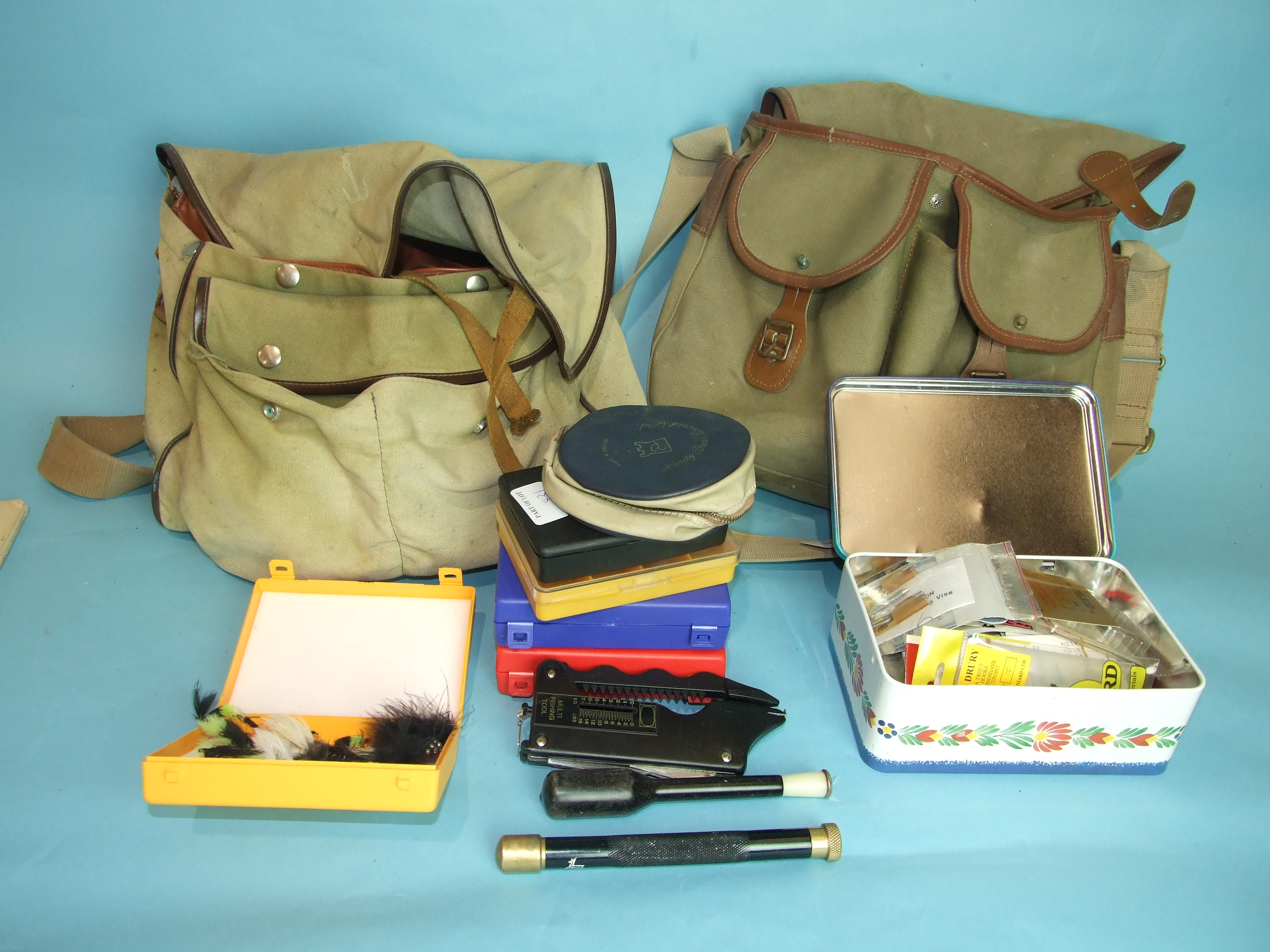 Lot 421 - Two canvas trout bags, a small collection of fishing flies, hooks and miscellaneous items.