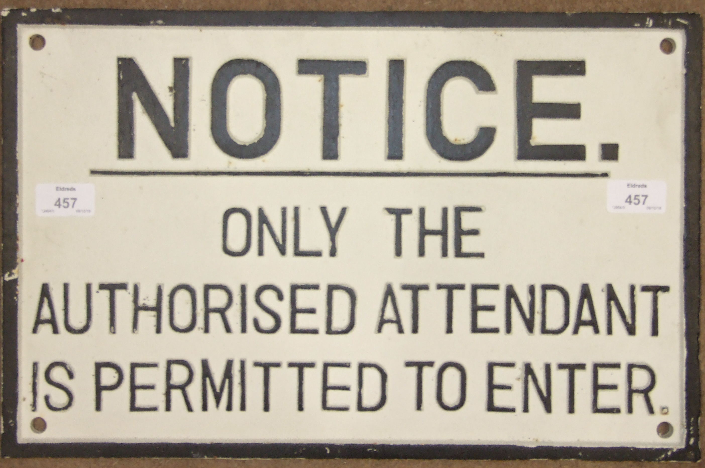 """Lot 457 - A cast iron sign """"Notice: Only The Authorised Attendant Is Permitted To Enter"""", 28 x 45cm."""