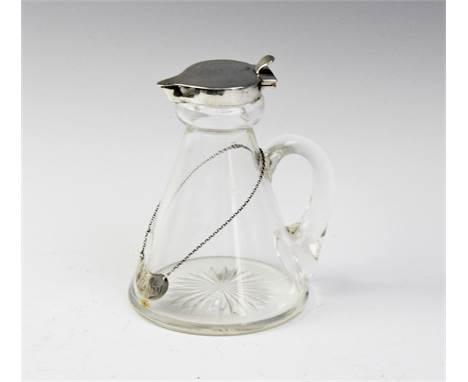 An Edwardian silver mounted glass whiskey noggin by James Deakin & Sons, Chester 1905, of typical handled conical form with s
