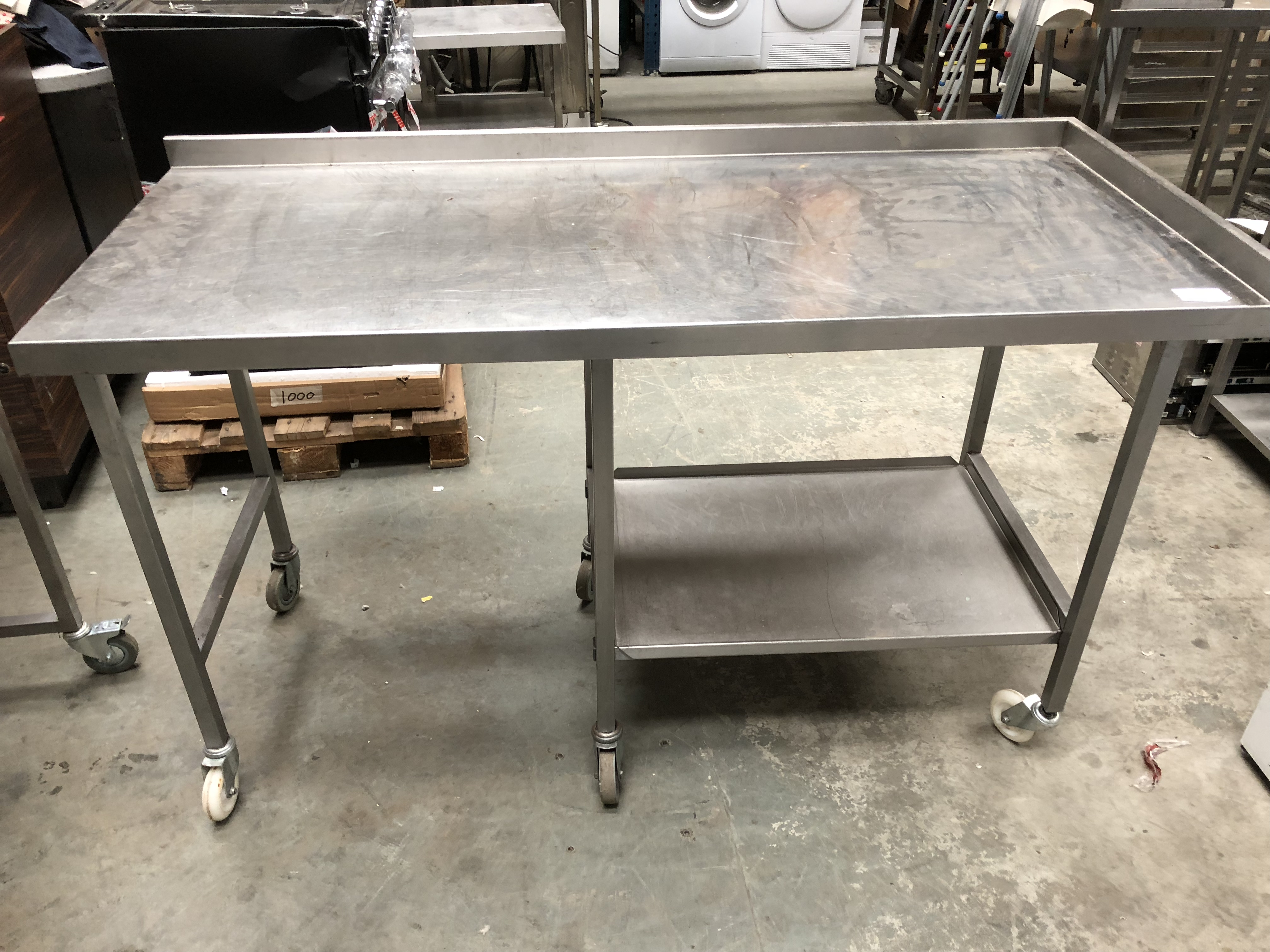 Lot 53 - Stainless Steel Table with Part Under Shelf