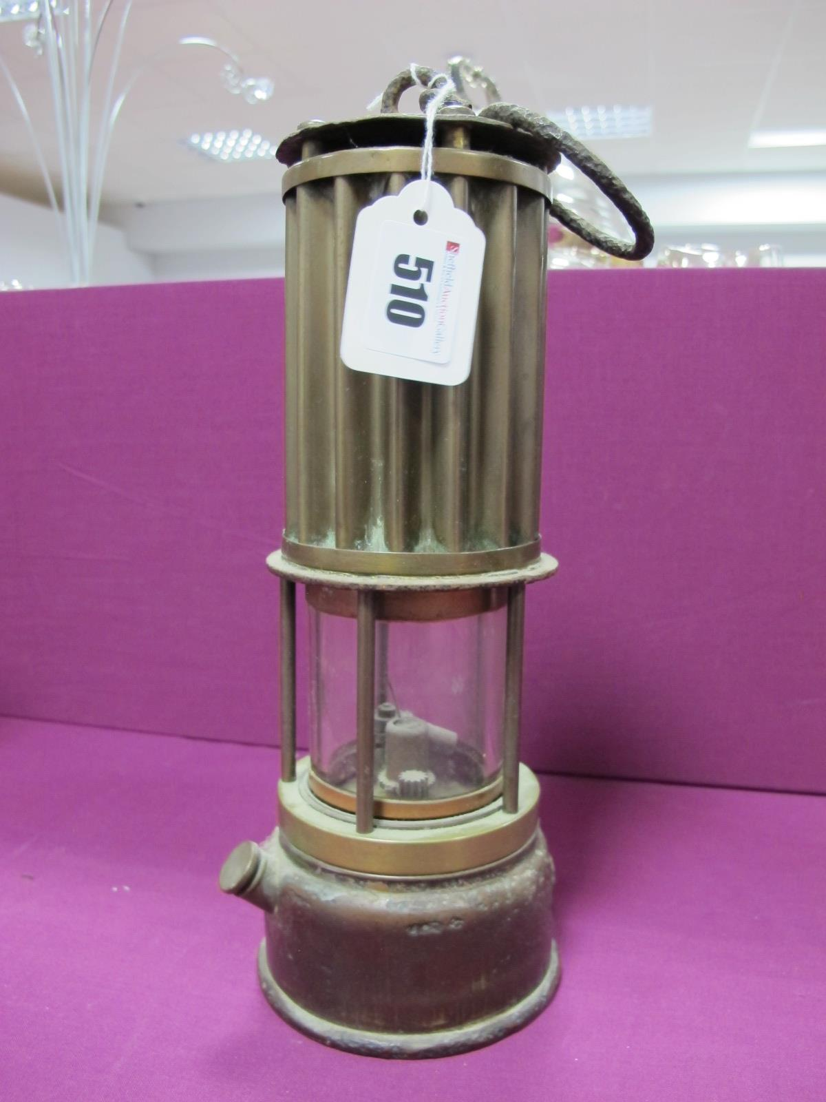 The Premier Lamp of Leeds Miners Lamp, having vertical ribbed upper body, 27cm high with