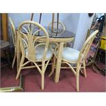 Cane Circular Topped Patio Table and Four Chairs. (5)