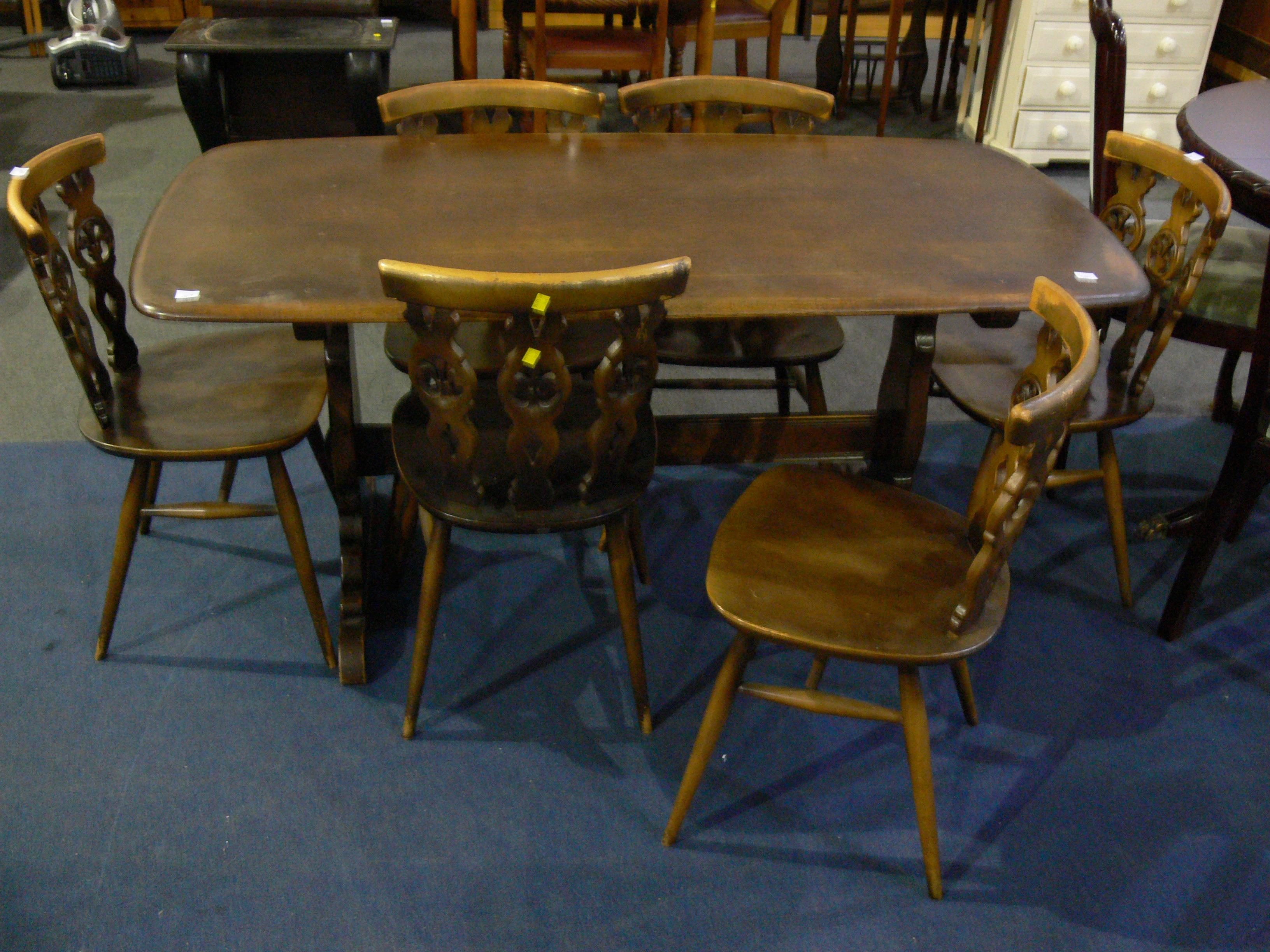 An ercol dining table with six chairs h71cm l152cm for John e coyle dining room furniture