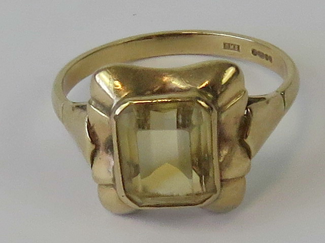 Lot 128 - A 9ct gold and citrine ring, emerald cut citrine of pale yellow hue approx 2ct,