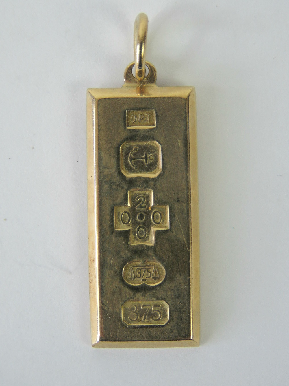 Lot 113 - A 9ct gold ingot pendant hallmarked Birmingham 2000, 4cm in length, 10.8g.