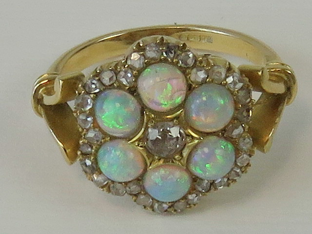 Lot 110 - An impressive 18ct opal and diamond ring,