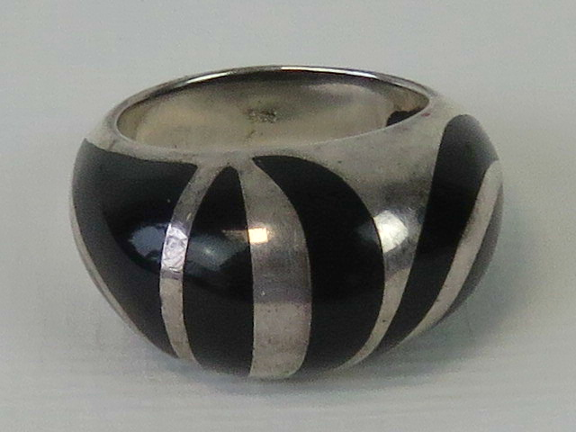 Lot 142 - A silver ring with unusual black enamel striped design, stamped 925, size M-N.