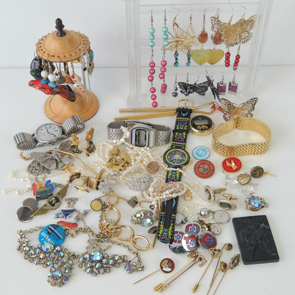 Lot 126 - A quantity of assorted costume jewellery including two earring display stands, watches, pendants,