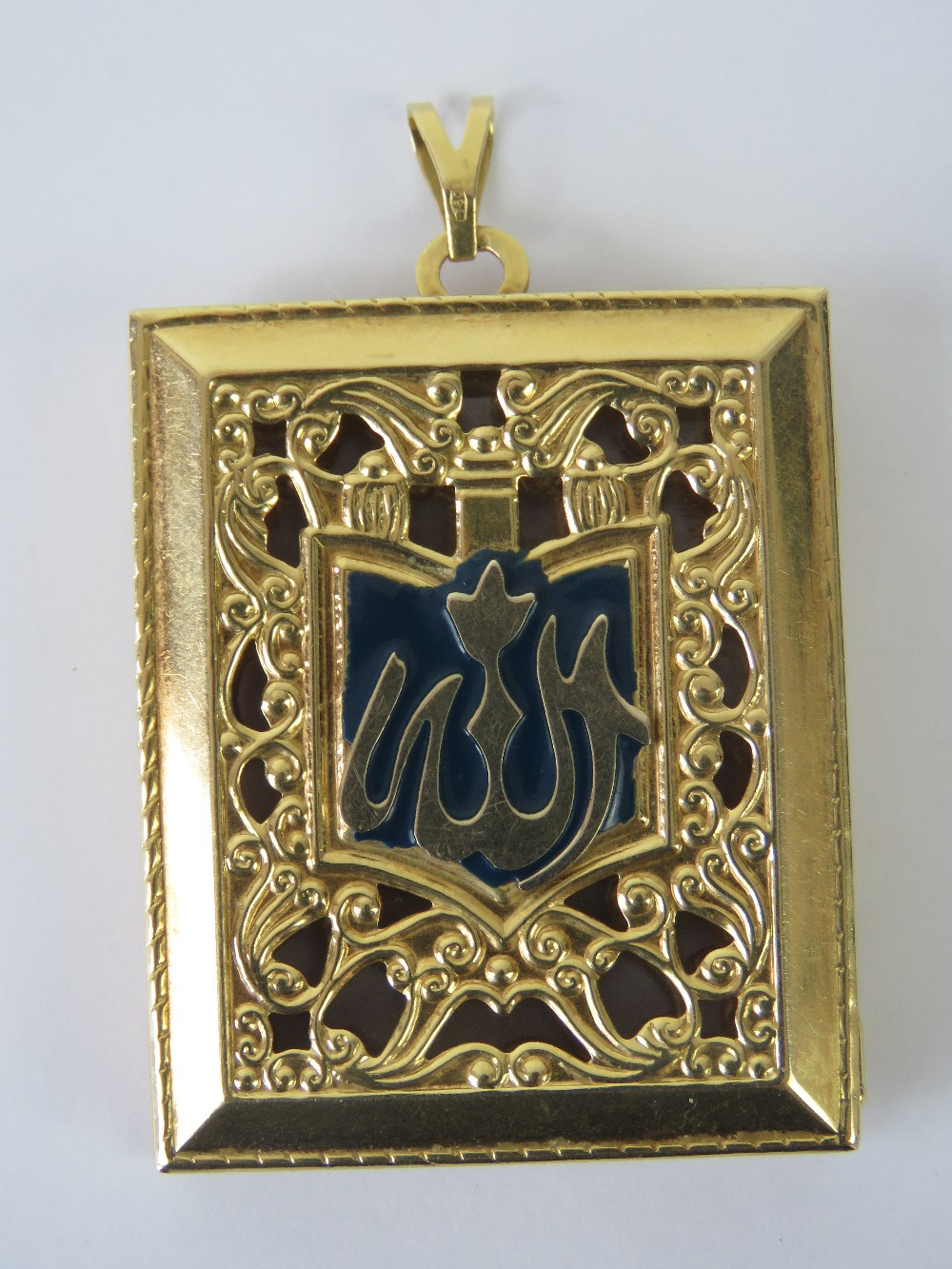 Lot 116 - A large 18ct gold locket in the form of a book having blue enamel to front and red enamel to back,