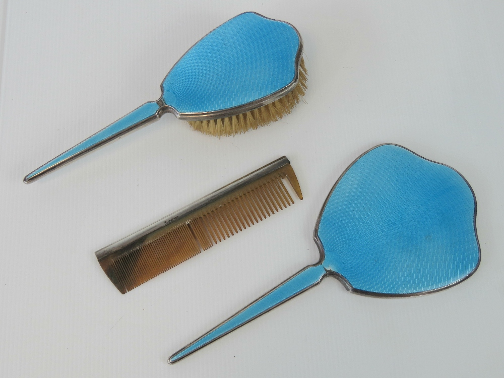 Lot 9 - A HM silver and enamelled three piece dressing table set comprising mirror, hairbrush and comb,