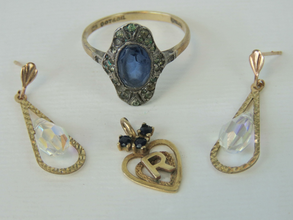 Lot 133 - A vintage 9ct gold and silver ring with central blue paste, a/f, size P,