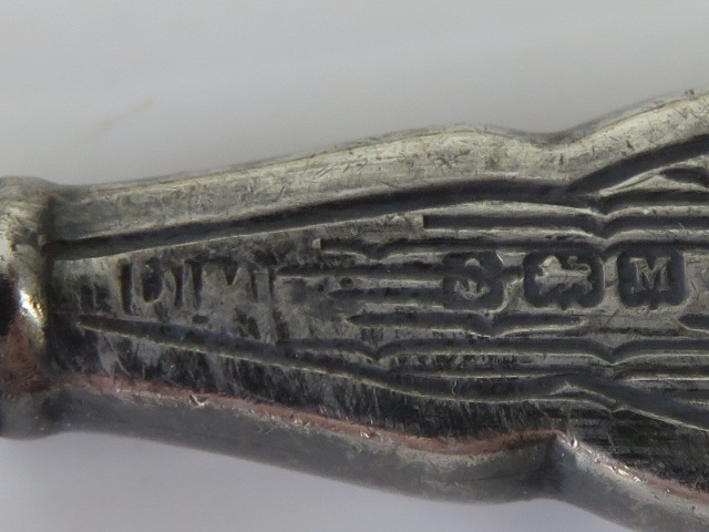 Lot 16 - A HM silver part necessaire comprising nail file, cuticle knife, buffer and rouge pot.