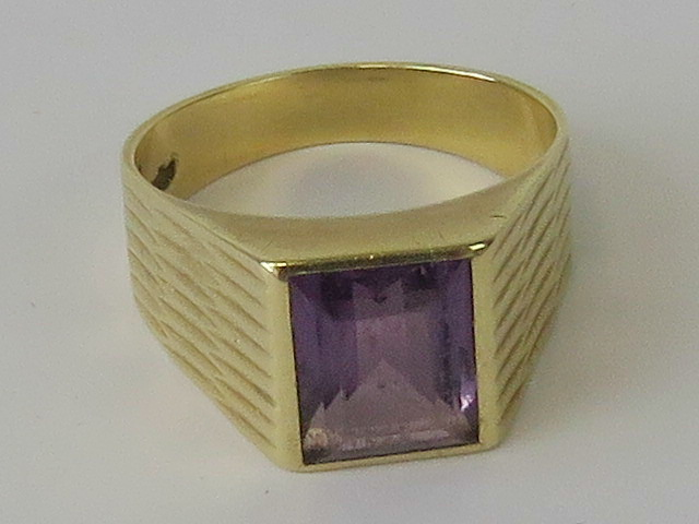Lot 119 - A 14ct gold and amethyst ring, large rectangular cut amethyst in rubover setting, approx 2.