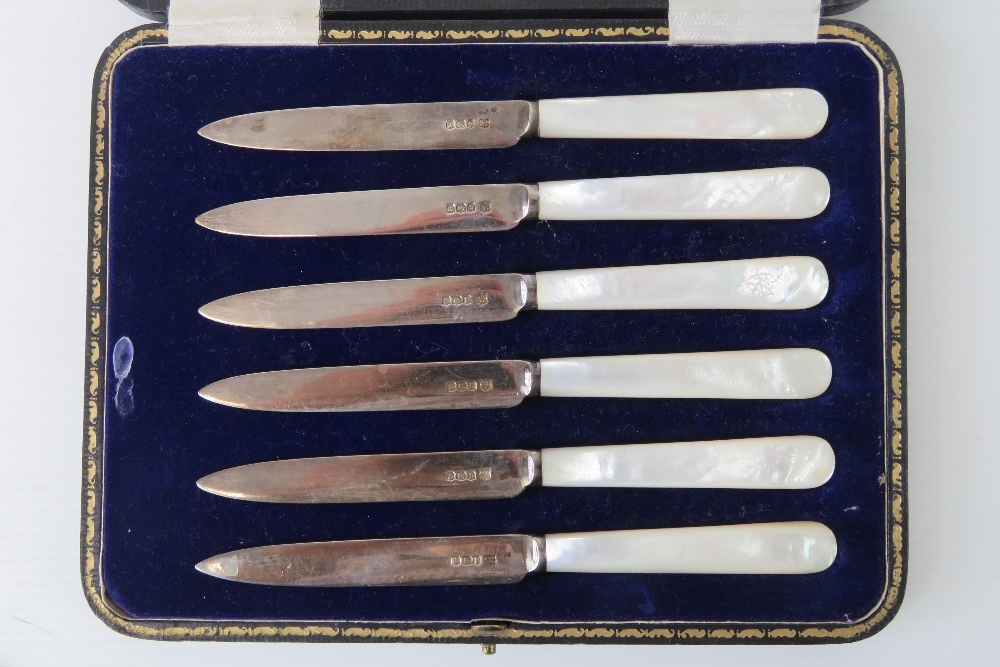 Lot 11 - A set of six HM silver and mother of pearl handled fruit knives,