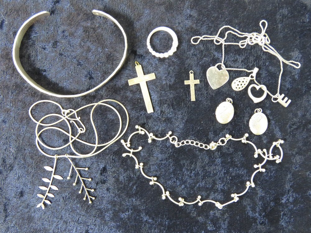 Lot 129 - A quantity of silver jewellery including bangle, lockets, cross pendants, anklet,