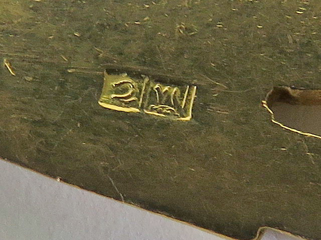 Lot 135 - A yellow metal pendant depicting the Egyptian god Horus, having single and double Arabic hallmark,