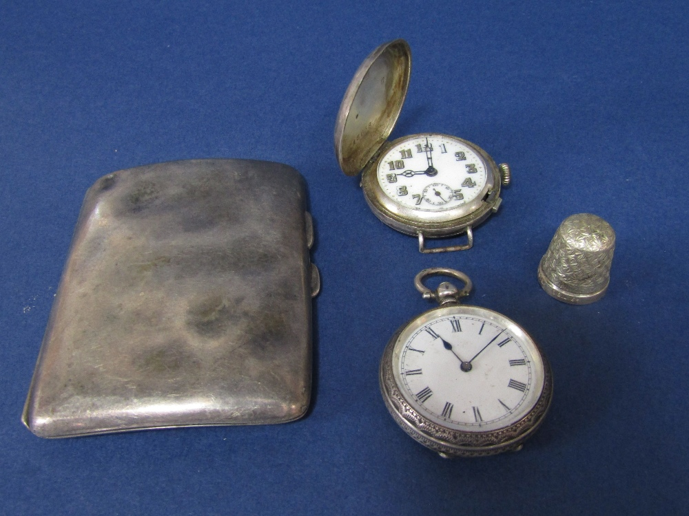 Lot 194 - Mixed collection of silver to include a silver cigarette case, thimble, fob watch and further silver