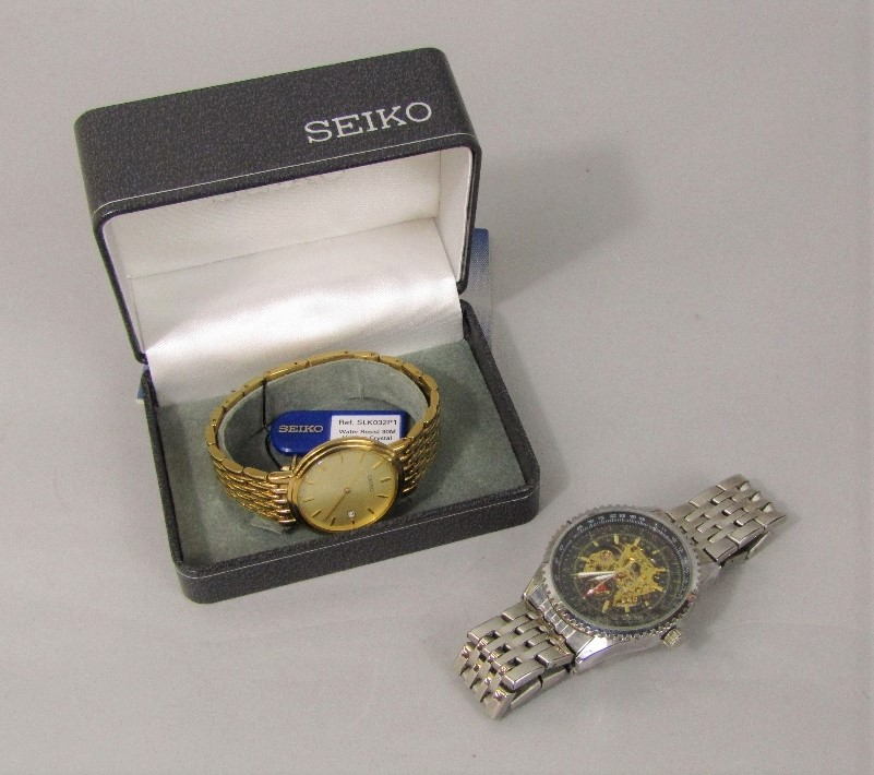 Lot 351 - Cased gold plated Seiko gents quartz wristwatch with date aperture, with box and booklet, together