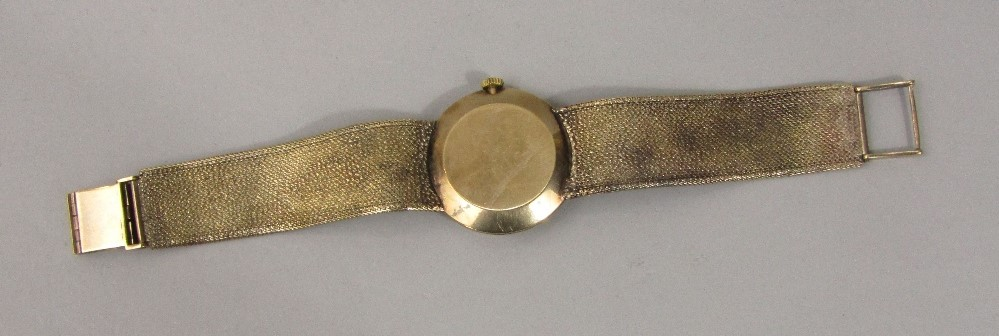 Lot 358 - Vintage 9ct Tissot gent's dress watch, the champagne dial with black baton markers upon a good