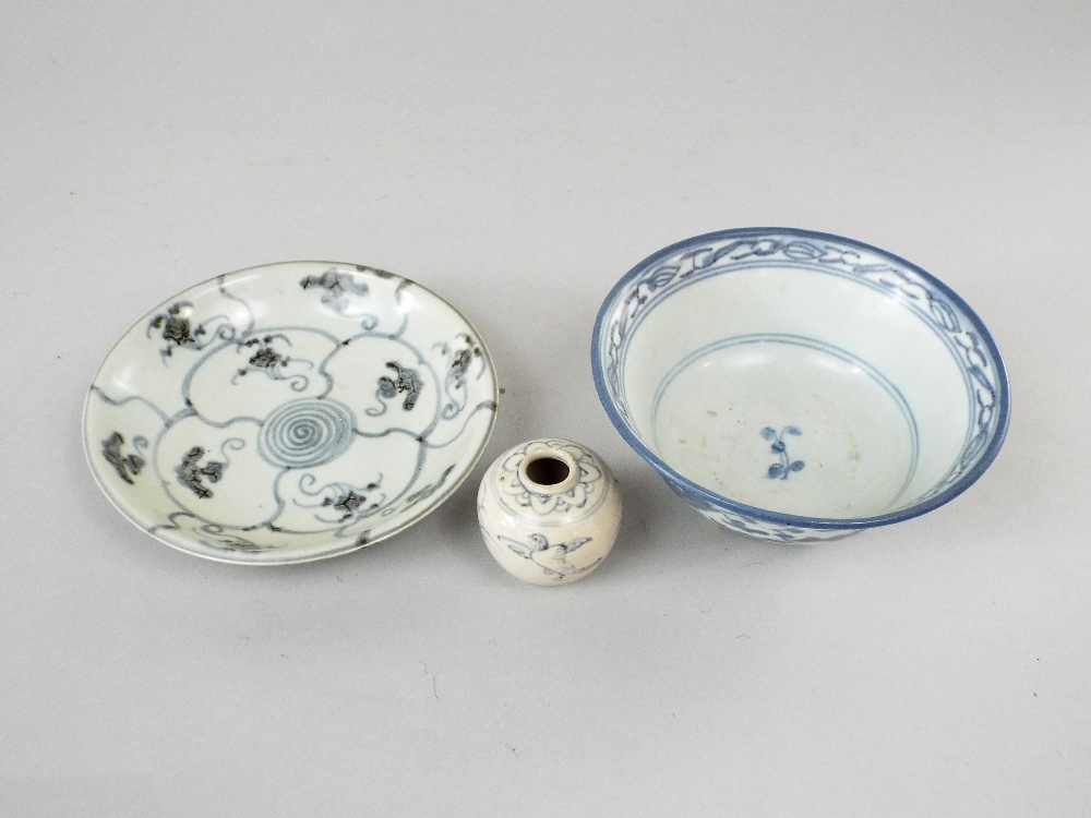 Lot 46 - A collection of three pieces of oriental ceramic recovered from shipwrecks and including small