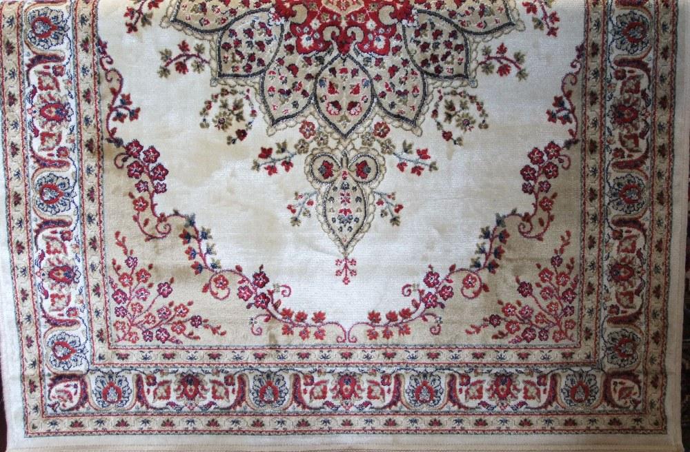 Lot 627 - Kashmir rug, floral medallion design, ivory and gold ground, 175 x 120cm