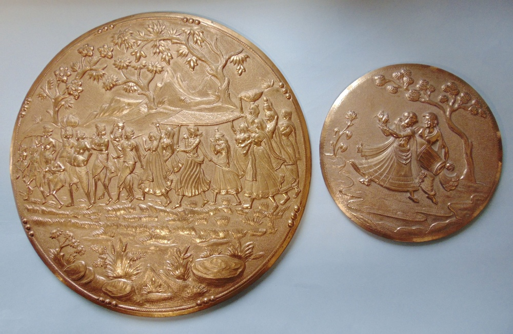 Lot 434 - Embossed Indian copper circular plaque decorated with a procession of figures in a mountainous