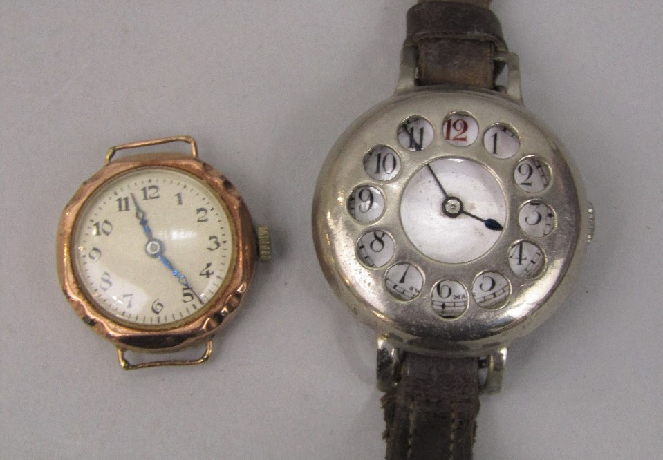 Lot 362 - Vintage ladies 9ct gold watch head with champagne dial and Arabic numerals, together with a trench