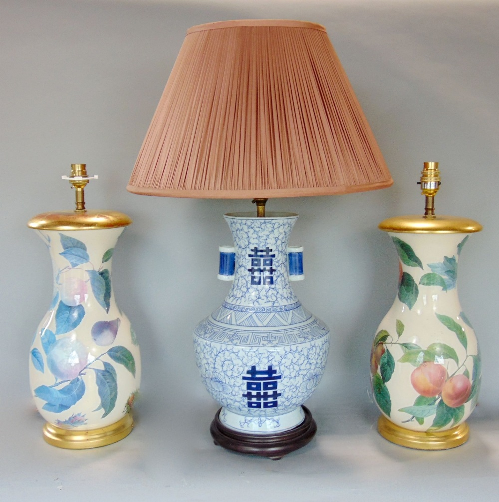 Lot 492 - Pair of glass baluster table lamps over a printed Evesham type pattern, 40 cm high together with a