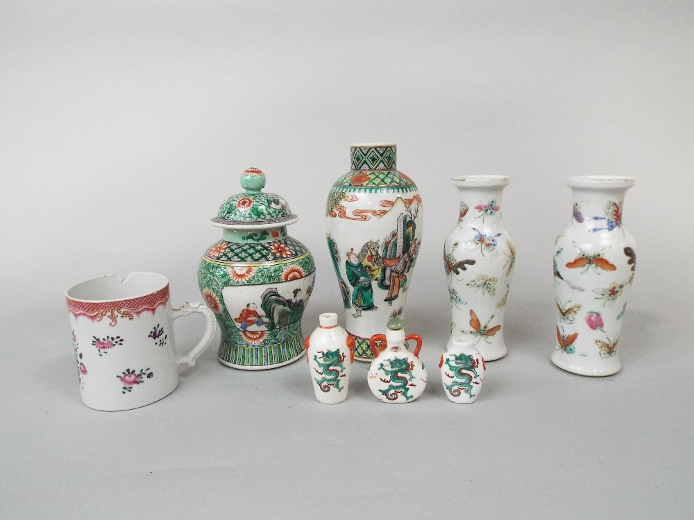 Lot 58 - A collection of oriental ceramics including a pair of white ground vases with polychrome butterfly