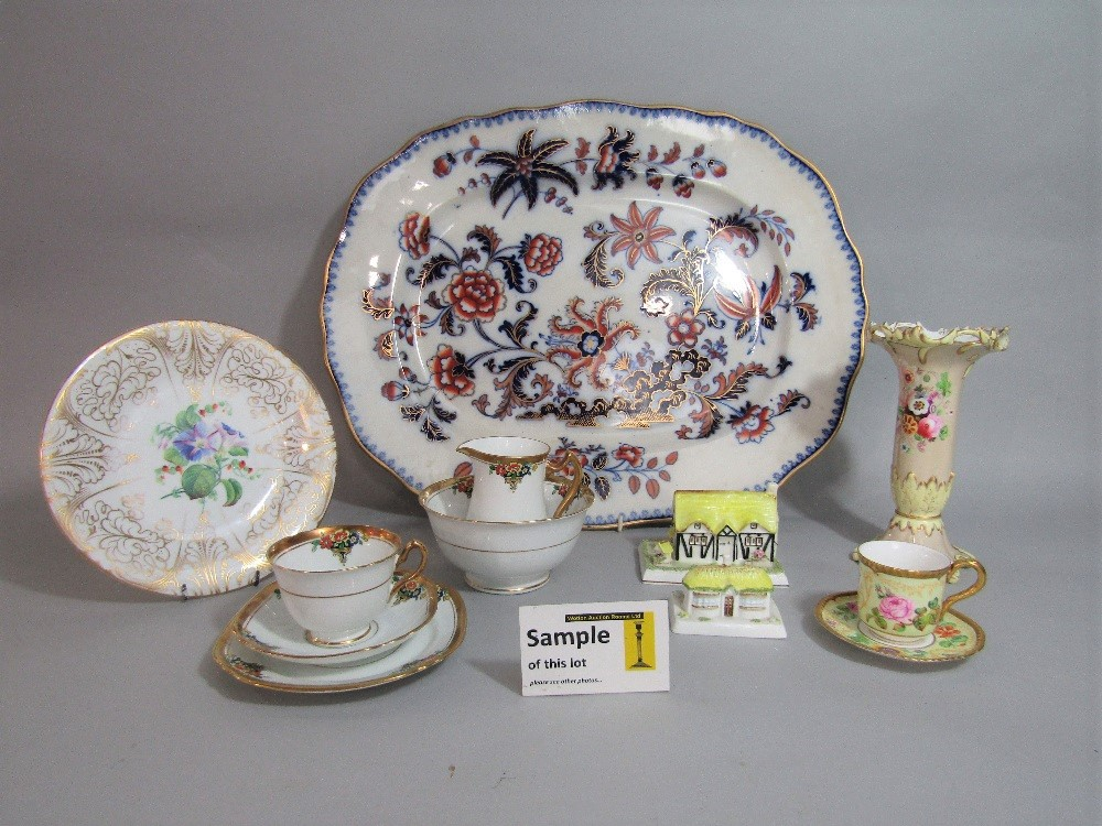 Lot 69 - A 19th century meat plate with printed and infilled chinoiserie style floral decoration, further