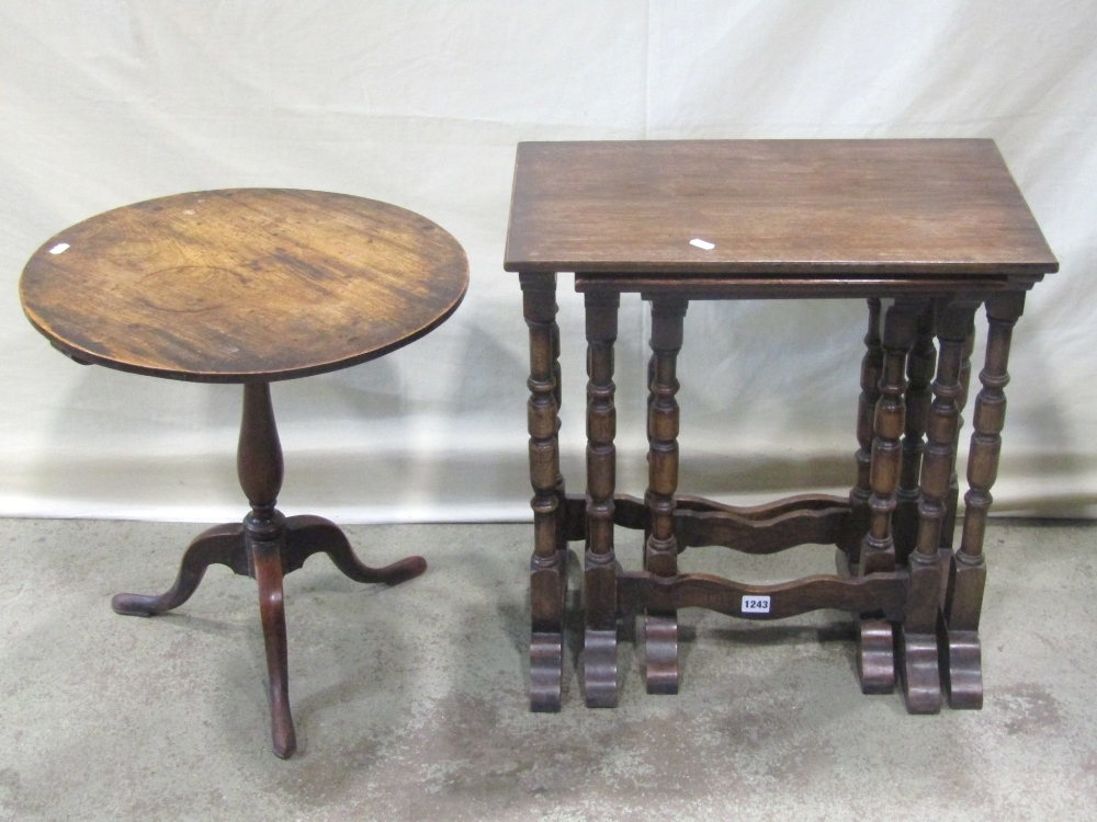 Lot 1243 - A nest of three good quality reproduction Old English style oak occasional tables, raised on